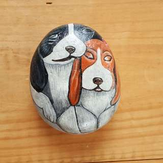 Individually acrylic hand painted on large pebble.  Two beautiful dogs in warm embrace.