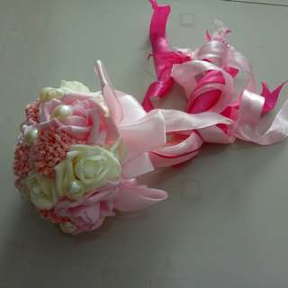 Hand bouquets and flower petals