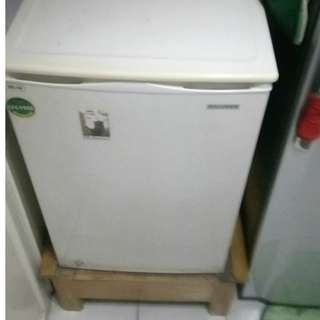 Small refrigerator with stand. Negotiable price.