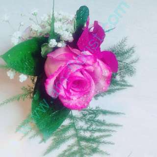 Purple roses corsages