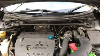Evo X stock front strut bar
