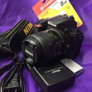 Nikon d5600 with 18-55mm lens accessories wifi ready flip and touch lcd almost new