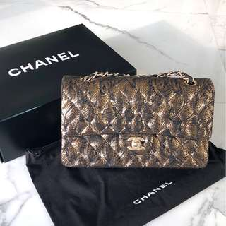 Chanel 2.55 gold & black handbag