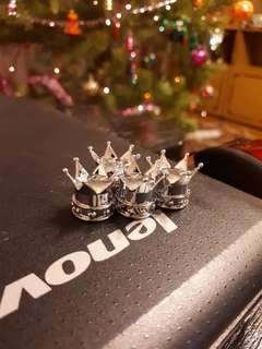 Silver 4 pcs crowns tyres air caps.