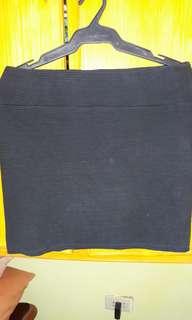 Cotto on black skirt