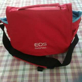 Canon DSLR. Eos Digital Camera Bag with compartments inside the camera bag.