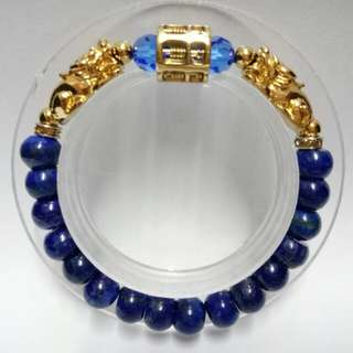 Abacus Lapis Gemstones (7x9mm) Bracelet with gold-plated stainless steel Abacus and Pixius Charms and blue crystals