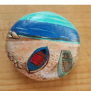 Individually acrylic hand painted on large pebble.  2 boats by the beach.