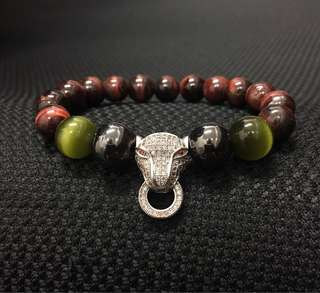 Green cat eye, magnetic gun mental with red tiger eye bracelet.