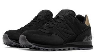 Brand New! New Balance 574 Black and Gold Mettalic shoe