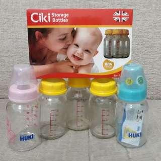 Botol kaca dan dot huki