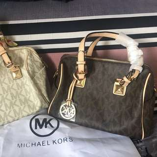 Michael Kors Grayson  per each bag the price mk brown slightly flaw