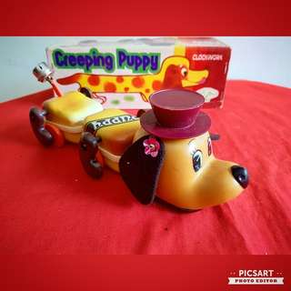 Vintage Winding Tin Toy of a Creeping Long & Cute Sausage Dog. Large, size as in photo. Good Condition and with box, working. $48, sms 96337309.