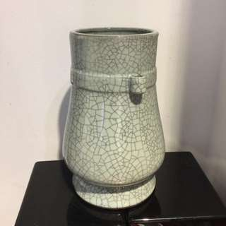 Celadon cracker jar (12 inches x 6 1/2 inches base)
