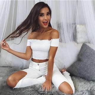 white ruffled off shoulder crop