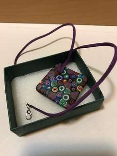 Glass pendant with leather chain
