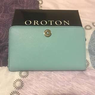 Oroton/ melanie large multi-purpose pocket sip around wallet