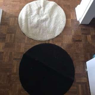 Two Circular Rugs