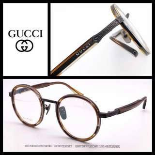 Gucci GG0067O round titanium spectacle frames