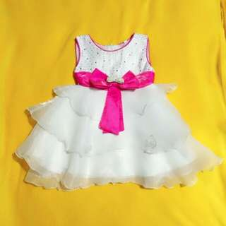 White dress with pink ribbon