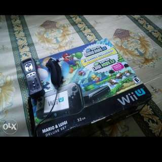 Nintendo Wii u with 7 physical games