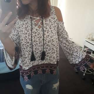 Floral long sleeve blouse with shoulder cut offs.
