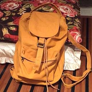 Mustard fourskin bagpack