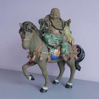 Buddha on horseback