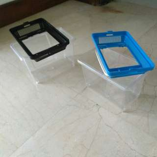 Two plastic portable fish tanks for sale
