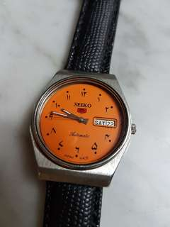 70's Vintage Seiko 5 Auto Day/Date Orange Dial with Arabic Marlers (NOS).
