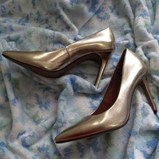 Gold pump heels