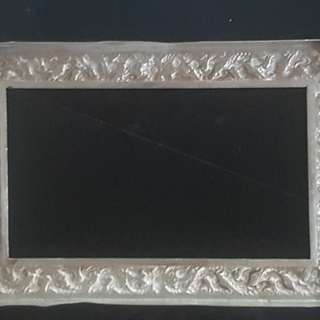 The silver frame