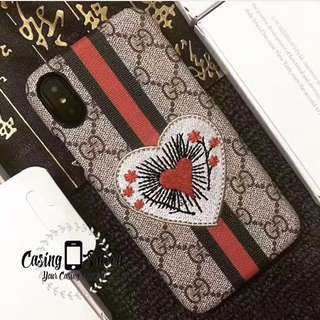 Gucci Embroidery Signature Case Collection