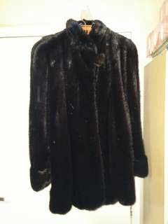 Ladie's black mink coat, 95% new