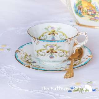 Antique hand-decorated English bone china teacup and saucer, art nouveau thistle design