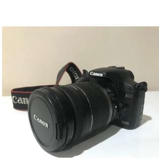 Canon 500D (body only) with lens and flash (sold separately)