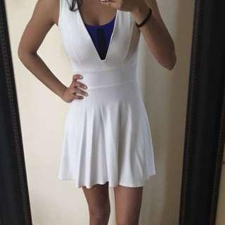 Low v-cut white dress