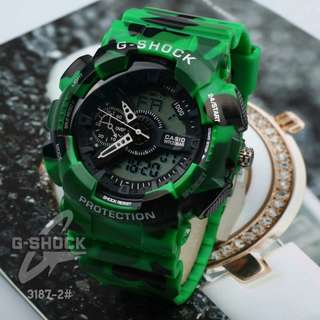 New G-SHOCK 3187-2#p   (Loreng) Diameter : 4,5cm Analog & Digital watch Semi Premium Material all Rubber Motif Loreng Ready 3 colours : - Blue - Green - Red  G-Shock Watches by Casio Feature : Date,Day, Month,Lamp and Stopwatch Sport Style Free box Weig