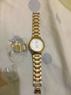 Pre-loved Unisilver gold watch