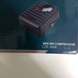 BNIB mini air compressor