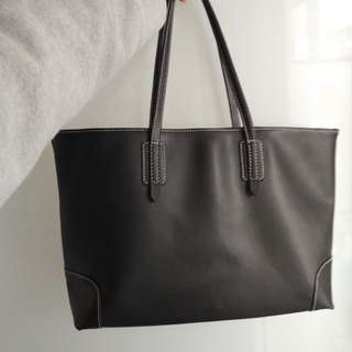 Black tote bag with white lining
