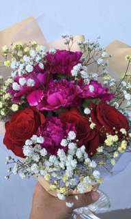 Fresh carnations with roses bouquet