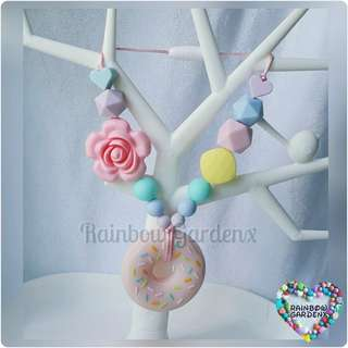 Donut teether with beads carrier accessory
