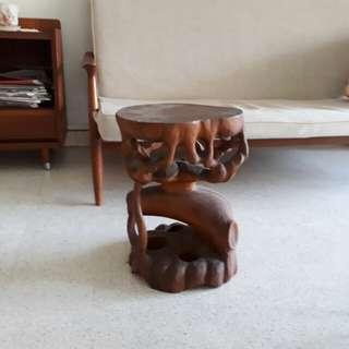 old stool or side table carved out of tree trunk
