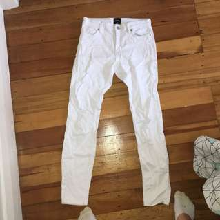 White ripped denim jeans by Riders