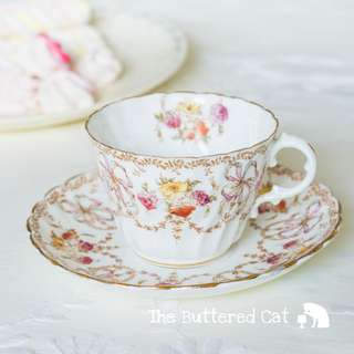 Lovely antique hand-decorated English bone china teacup and saucer, pretty ribbon bows and floral swags, garlands