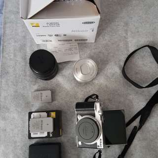 Nikon camera J5 used once only.  Wifi . Singapore set with warranty
