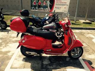 Red Vespa GTS 200 with nice number plate