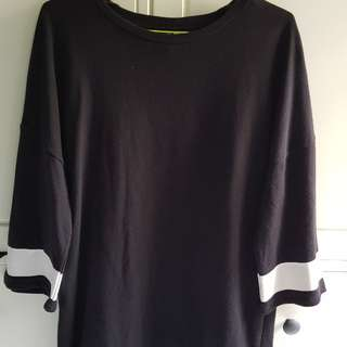 Oversized top with troublemaker embroidery