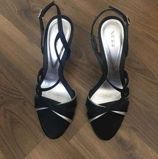 Black open-toe sandals with heels